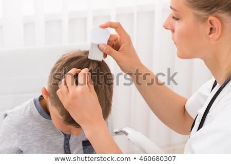 Arts behandeling haren persoon hand Stockfoto © AndreyPopov