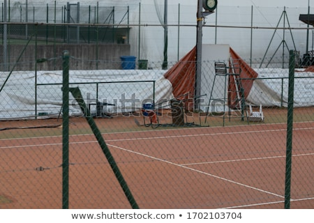 Empty all weather tennis court with umpires chair Stock photo © Giulio_Fornasar