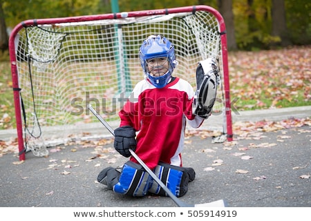 boy dressed to be the goalie in a street hockey game Stock photo © Lopolo