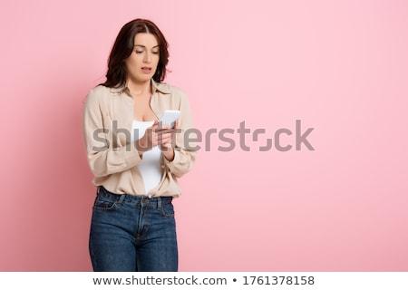 Gyönyörű barna hajú nő portré lány pózol kék Stock fotó © zastavkin