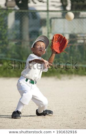 boy playing sport baseball or softball stock photo © lovleah