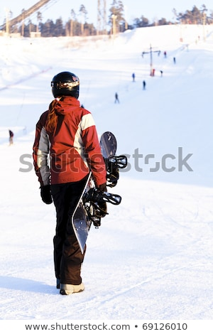 Female snowboarder on the snowhill. Stock photo © Nobilior
