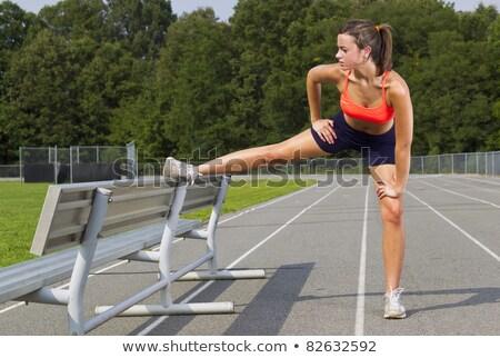 Hamstring stretch female athlete on running track Stock photo © darrinhenry