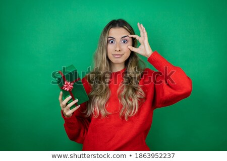 Stock photo: beautiful woman with wide open eyes holding red present
