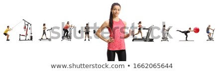 Sporty young girl drinking bottled water with other young sports people in the background Stock photo © photography33