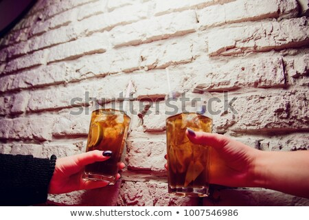 Two women having a soft drink on a terrace. Stock photo © photography33