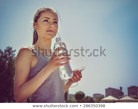 Sporty caucasian girl with water bottle stock photo © aremafoto