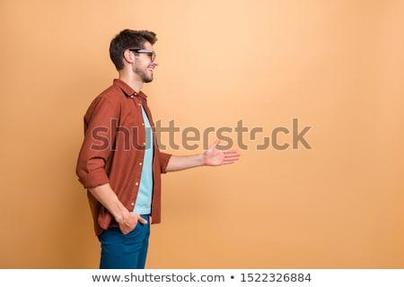 Jeune homme main handshake jeunes souriant homme Photo stock © elly_l