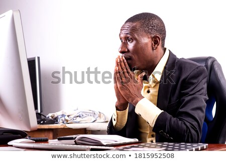 African businessman hoping for good news Stock photo © photography33
