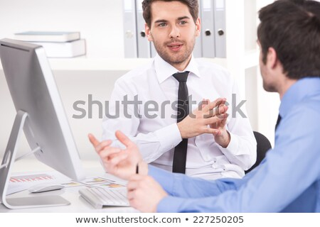 Two businesspeople reviewing notes Stock photo © photography33