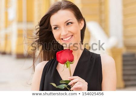 Gyönyörű lány piros rózsa fiatal virág kezek arc Stock fotó © pzaxe