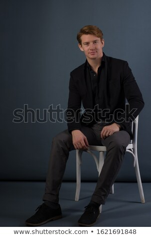 arrogant man sitting on gray Stock photo © feedough