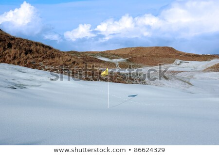 Сток-фото: Links Golf Course Green With Snow And Yellow Flag