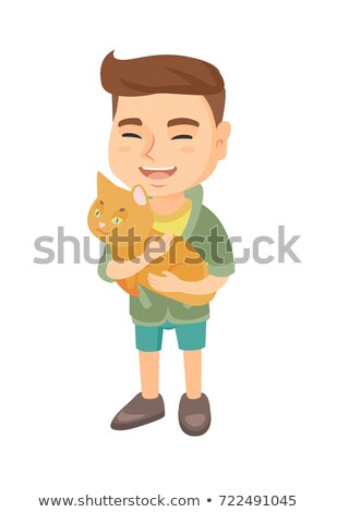 Happy boy with a cat stock photo © oneinamillion