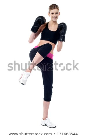 Smiling young female boxer ready to punch you Stock photo © stockyimages