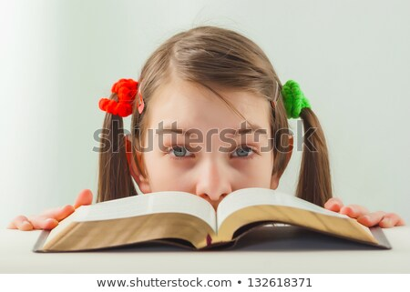 Surprised teen girl with the Bible Stock photo © AndreyKr