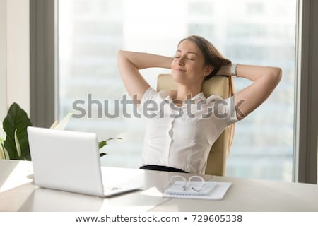 Calm corporate woman relaxing in office Stock photo © stockyimages