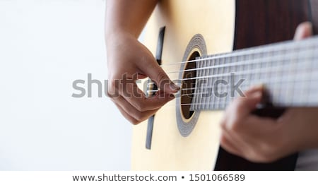 Closeup of guitarist hand playing guitar Stock photo © williv
