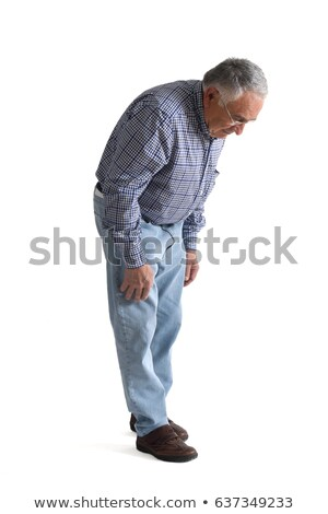 crouched casual man looks down stock photo © feedough