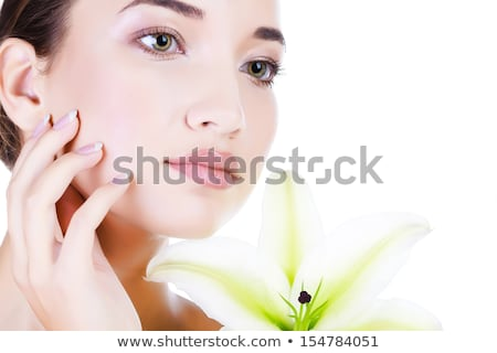 Beautiful face of young asian woman with big lily. Stock photo © Nobilior