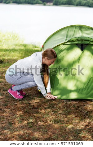 woman pitching tent Stock photo © diego_cervo