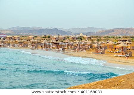 guarda-sol · colorido · areia · praia · céu · sol - foto stock © tomjac1980