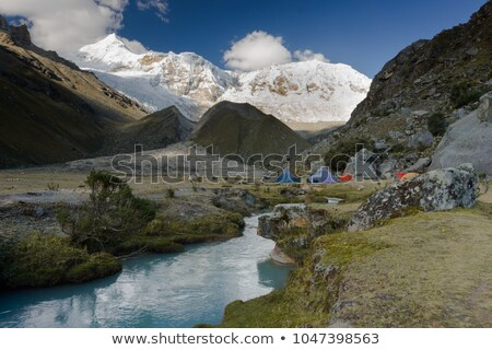 Green tent pitched on the bank of a lake. Stock photo © belahoche