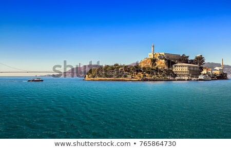 Alcatraz jail in San Francisco and Golden Gate Bridge Stock photo © hanusst