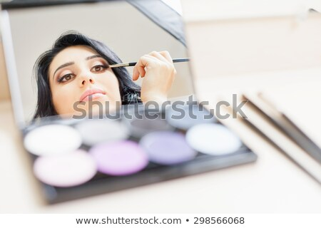 doing the makeup brown eyeshadow on beautiful eyes stock photo © juniart