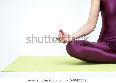 happy girl sitting in lotus pose stock photo © nejron