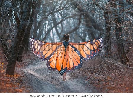 relaxed woman with the huge wings stock photo © konradbak