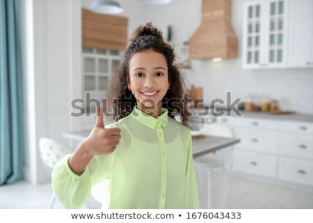 glimlachend · student · meisje · tonen · onderwijs - stockfoto © dolgachov