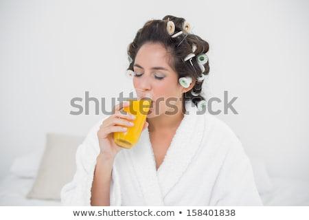 Nő fürdőkád köntös iszik narancslé gyönyörű Stock fotó © dash