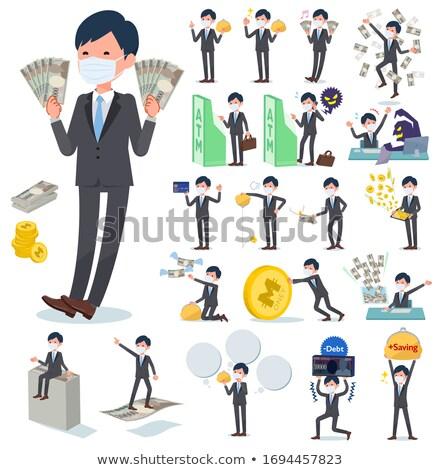 wealthy successful businessman burning money stock photo © juniart