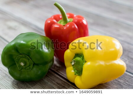 Whole yellow bell pepper on kitchen table Stock photo © ShawnHempel