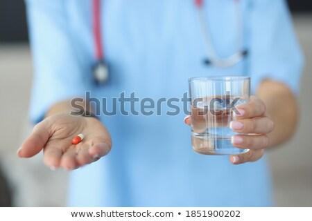 врач рук капсула стекла воды фотография Сток-фото © dolgachov