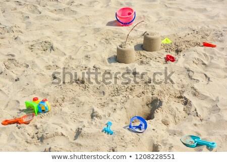 Children's colorful sandy toys on beautiful a beach. India Goa Stock photo © mcherevan