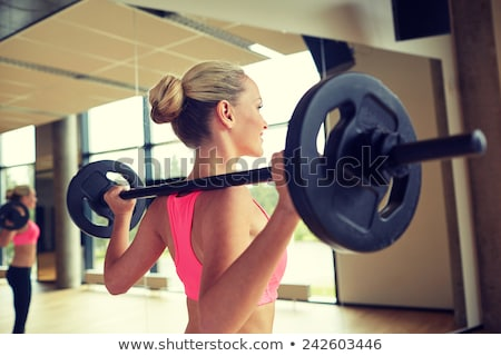 fitness woman working out with barbell stock photo © deandrobot