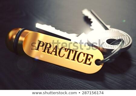 practice   bunch of keys with text on golden keychain stock photo © tashatuvango
