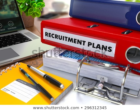 Red Ring Binder with Inscription Recruitment Plans. Stock photo © tashatuvango