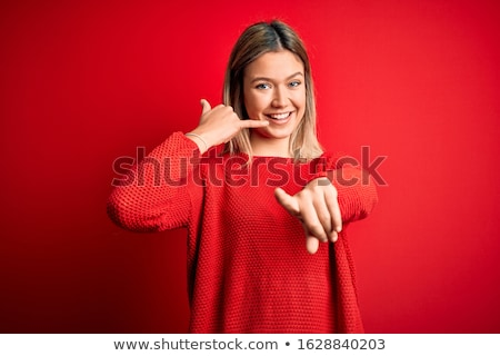 Happy woman making a call me gesture  Stock photo © deandrobot