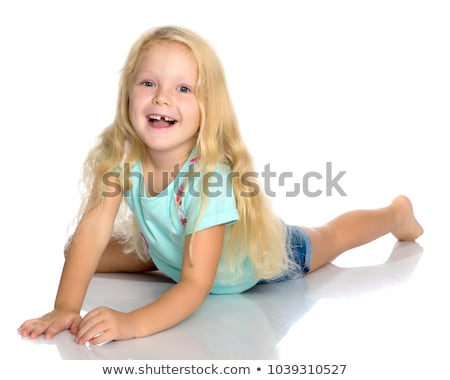 pretty smiling little girl lies on floor   Stock photo © Paha_L
