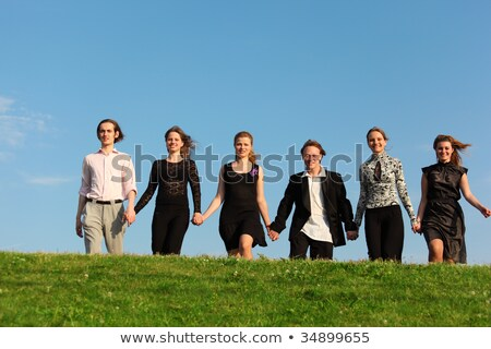 Six friends go on meadow having joined hands Stock photo © Paha_L