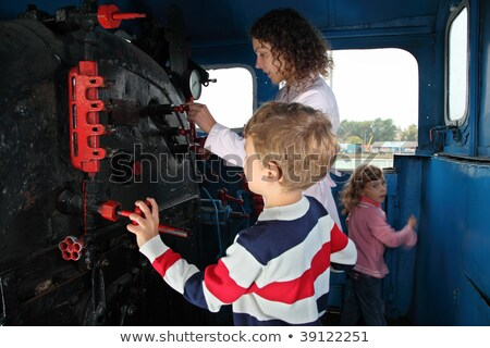 mother with children in locomotive cabin stock photo © paha_l