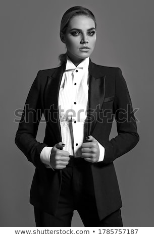 glamorous young woman in black suit Stock photo © Aikon