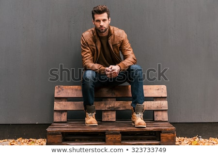 man in leather jacket posing looking at the camera stock photo © feedough