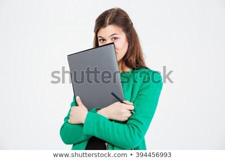 Cute młoda kobieta zielone kurtka ukrywanie za Zdjęcia stock © deandrobot