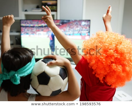 kids with football watching soccer world cup game 2014 on tv in stock photo © zurijeta