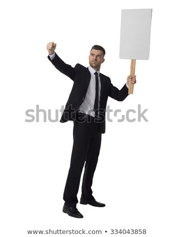 Full length of serious young man standing and holding whiteboard Stock photo © deandrobot