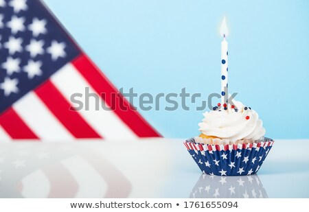 fourth of july cupcake with light candle stock photo © tab62